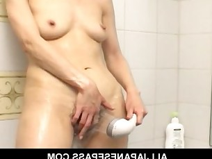 Horny Japanese MILF showers and toys her soaking wet pussy