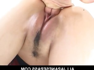 Horny cougar Naami Hasegawa in fishnets teasing her pussy